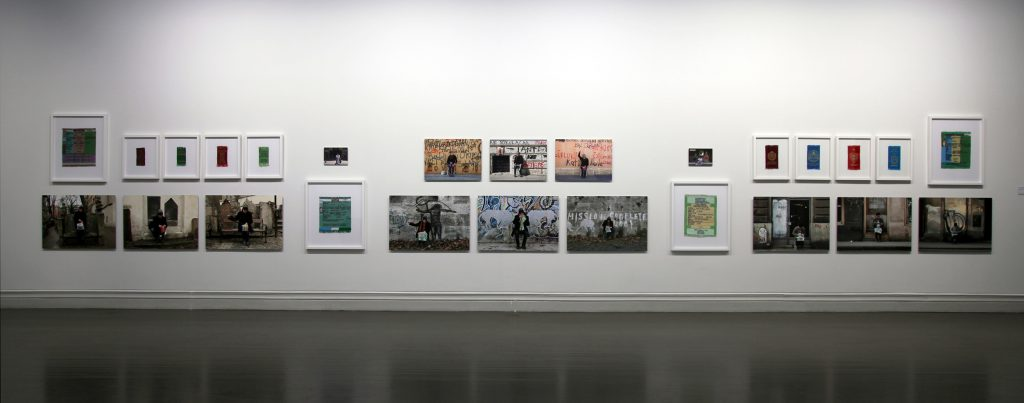 Photo from an art exhibition, where artworks are installed on the wall