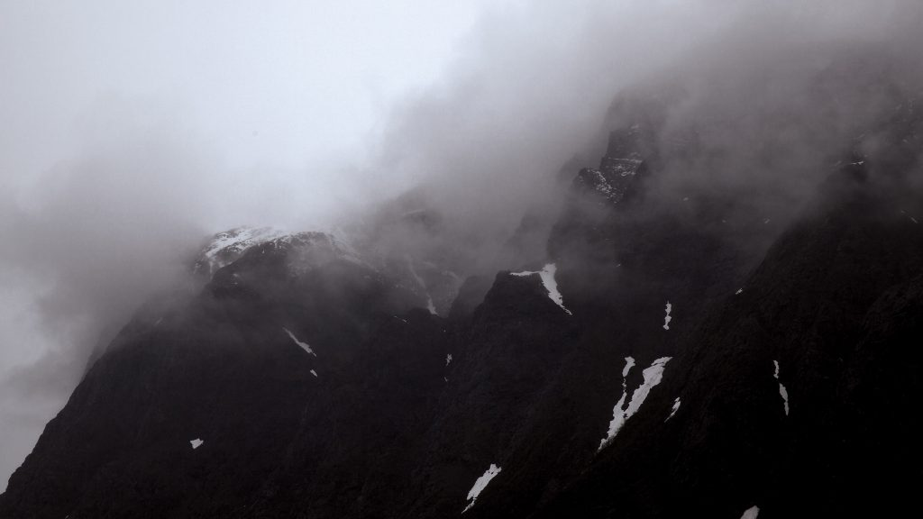 Photo of mountain cliffs in fog